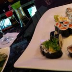 wine and sushi at happy hour