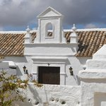 Traditional whitewashed buildings with beautiful tile roofs.