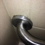 The shower smelled strongly of mildew.  The mold around the handles had something to do with tha
