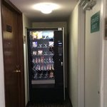 Room 115 on left, vending machine in center, stairwell on right. Pop machine and ice machine beh