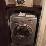 Washer/dryer and a safe