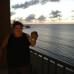 Enjoying a Cold Coconut at Sunset from balcony -