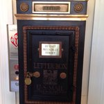 Old mail chute collection box by 1st floor elevator.