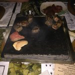 Sizzling the meats on a 600c stone
