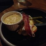 Poached egg, applewood bacon, and grits