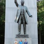 My nieces at the base of the huge TR statue