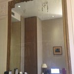 large vintage mirror in the room