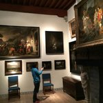 Room filled with paintings (not by him) where he woukd have entertained potential buyers