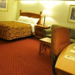 Guest room with desk and sofa at Shepherd Mountain Inn & Suites