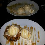 Warm waffle topped with Banoffee pie icecream served with whipped cream and caramel sauce