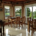 The breakfast room is bathed in morning sunshine.