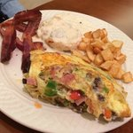 Cooked to order veggie and sausage omelette, bacon, potatoes and biscuit. Great breakfast