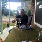 Mike enjoys coffee on the front porch