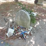 People leave notes and pens at Louisa May Alcott's grave