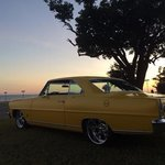 My 67 Nova SS in front of the hotel at sunset