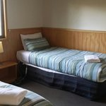 a room with 2 single beds