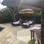 the sunloungers by our pool