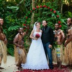 """The Fijian """"warriors"""" (resort staff) that carried me in. I call them my bridesmaids. :)"""