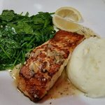 Atlantic salmon with mashed potatoes and garlic spinach.
