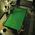 Playing billiard game