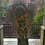 Second storey statue infront of staircase.