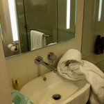 lights in mirror & reflection of 'great'shower, huge towels, always tempted to waste time & wate