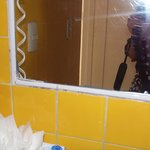 another villa with chipped, dirty tiles and substandard bath