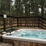 Hot tub on the back of my Meadow Home (glass of wine courtesy of resort)