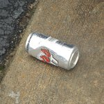 Beer cans littered the parking lot