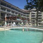 Pool, restaurant above and rooms