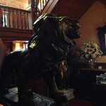 Lion at the base of the grand stairwell in main hallway.