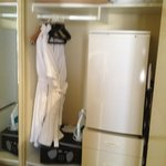 Closet with safe, mini bar and dressing gowns