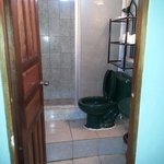 Bathroom with a very high step up to the toilet and shower