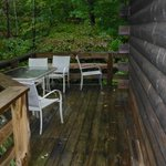 Narrow deck and dirty outdoor furniture.