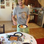 Andrew serving lunch (Chicken Paprikash with dumplings and cucumber salad)