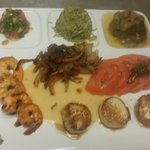 Scallops and shrimp with chipotle cream sauce and caramelized red onions.