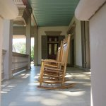 Rocking chairs on the front porch - waiting for visitors to stop and rest