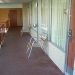 Exterior walkway with ash trays and chairs