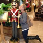 My wife blowing a kiss to one of the Holiday nutcrackers.