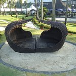 Adam and Eve seating by the pool