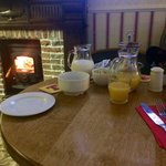 Cosy breakfast by the fire.