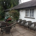 Smoking table and chairs in the garden - the chairs are directly underneath a bedroom window