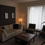 Lounge area - two seater sofa, two armchairs, large flat screen TV