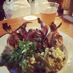 Chili roasted Cornish game hen with black bean cheddar tamales and a cactus and corn salad.