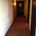 "Long hallway with bathroom on the left. At the end of the ""suite"" hallway it's really just a reg"