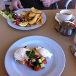 Brekky consists of Fish and chips ($15) for him, poached egg ($10) for me