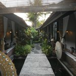 pathways to the rooms and pool
