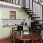 Kitchen, dining and stairs to bedroom