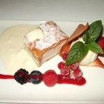 Creamy milk strudel with vanilla foam,fresh berries and sour ice cream