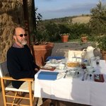 my husband on the terrace outside our room, with breakfast